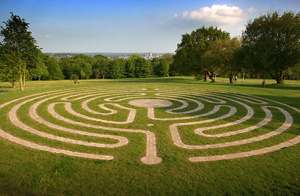 Labyrinth in flat stones on grass